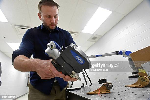 Ryan Gilley Engineer Technician uses a laser to scan a helicopter bracket on March 16 2016 in Edgewood Md The scan is the first step in replicating...