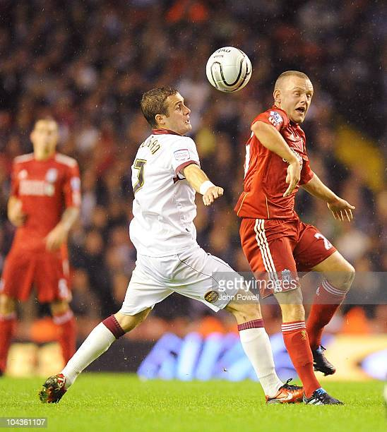 Ryan Gilligan of Northampton Town and Jay Spearing of Liverpool go for the ball during the Carling Cup 3rd round game between Liverpool and...