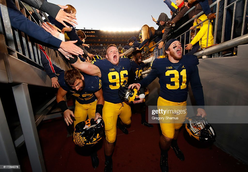 Ryan Glasgow #96 and Scott Sypniewski #31 of the Michigan Wolverines leave the field after a 41-8 win over the Illinois Fighting Illini on October 22, 2016 at Michigan Stadium in Ann Arbor, Michigan.