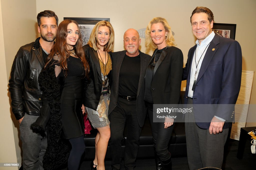 Ryan Gleason, Alexa Ray Joel, Alexis Roderick, <a gi-track='captionPersonalityLinkClicked' href=/galleries/search?phrase=Billy+Joel&family=editorial&specificpeople=203097 ng-click='$event.stopPropagation()'>Billy Joel</a>, <a gi-track='captionPersonalityLinkClicked' href=/galleries/search?phrase=Sandra+Lee+-+Television+Personality&family=editorial&specificpeople=242799 ng-click='$event.stopPropagation()'>Sandra Lee</a>, and New York Governor <a gi-track='captionPersonalityLinkClicked' href=/galleries/search?phrase=Andrew+Cuomo&family=editorial&specificpeople=228332 ng-click='$event.stopPropagation()'>Andrew Cuomo</a> pose backstage at the <a gi-track='captionPersonalityLinkClicked' href=/galleries/search?phrase=Billy+Joel&family=editorial&specificpeople=203097 ng-click='$event.stopPropagation()'>Billy Joel</a> New Year's Eve Concert at the Barclays Center of Brooklyn on December 31, 2013 in New York City.