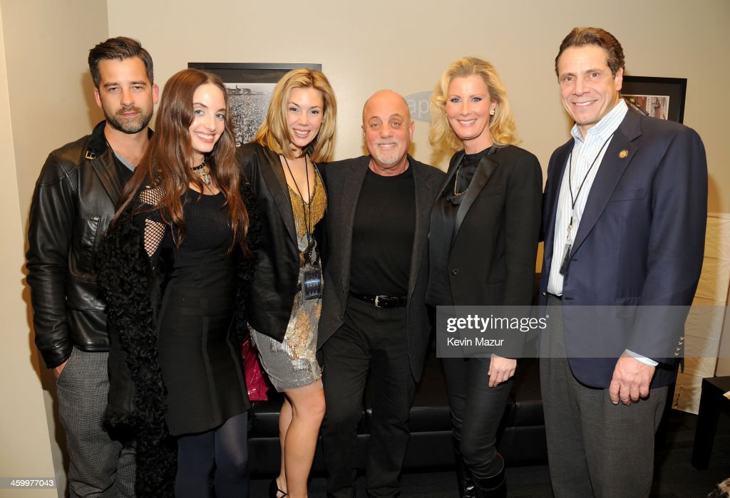 Ryan Gleason, Alexa Ray Joel, Alexis Roderick, Billy Joel, Sandra Lee, and New York Governor Andrew Cuomo pose backstage at the Billy Joel New Year's Eve Concert at the Barclays Center of Brooklyn on December 31, 2013 in New York City.
