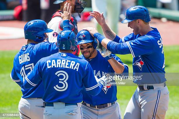 Ryan Goins Ezequiel Carrera and Michael Saunders celebrate after Devon Travis of the Toronto Blue Jays hit a grand slam home run during the fourth...