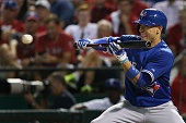Ryan Goins lines up a bunt The Toronto Blue Jays and Texas Rangers play game three of the MLB American League Division Series at Globe Life Park in...