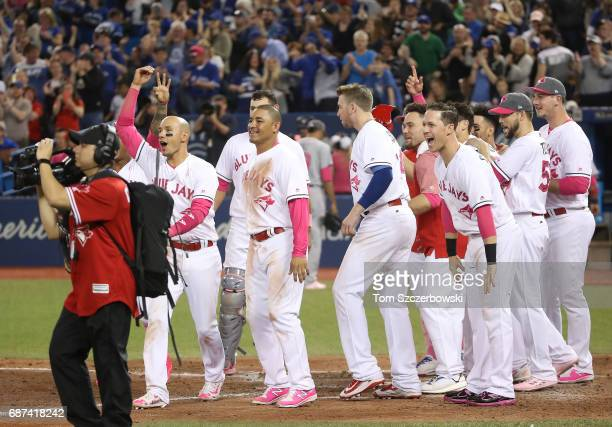 Ryan Goins of the Toronto Blue Jays and Ezequiel Carrera and Chris Coghlan and teammates wait to greet Kevin Pillar after his gamewinning solo home...