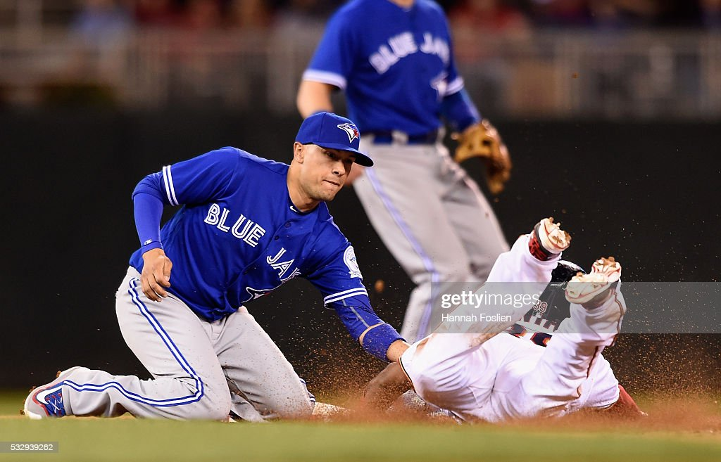 Ryan Goins #17 of the Toronto Blue Jays catches Danny Santana #39 of the Minnesota Twins stealing second base during the eleventh inning of the game on May 19, 2016 at Target Field in Minneapolis, Minnesota. The Blue Jays defeated the Twins 3-2 in eleven innings.