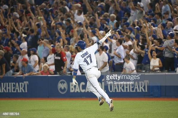 Ryan Goins of the Toronto Blue Jays celebrates as he hits a gamewinning tworun home run in the tenth inning during MLB game action against the...