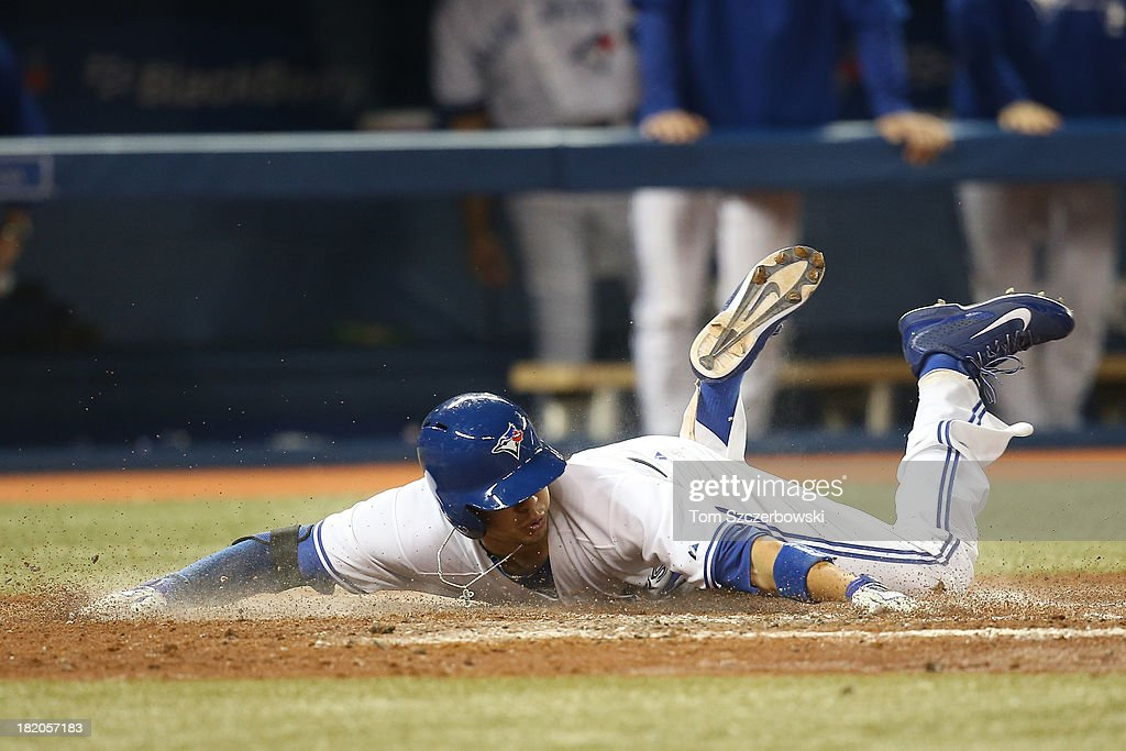 Ryan Goins #17 of the Toronto Blue Jays is shown after being thrown out at home plate trying to score on an error on his fourth-inning, RBI single during MLB game action against the Tampa Bay Rays on September 27, 2013 at Rogers Centre in Toronto, Ontario, Canada.