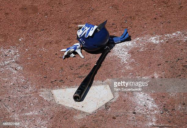 Ryan Goins of the Toronto Blue Jays leaves his bat and helmet and batting gloves at home plate after being called out on strikes to end the seventh...