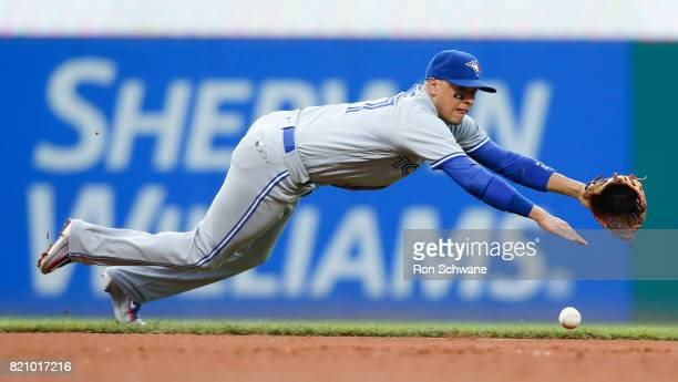 Ryan Goins of the Toronto Blue Jays makes a diving attempt on a single by Giovanny Urshela of the Cleveland Indians during the fifth inning at...