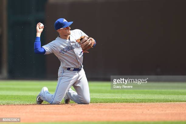 Ryan Goins of the Toronto Blue Jays makes a throw to first base during the first inning of a game against the Chicago Cubs at Wrigley Field on August...
