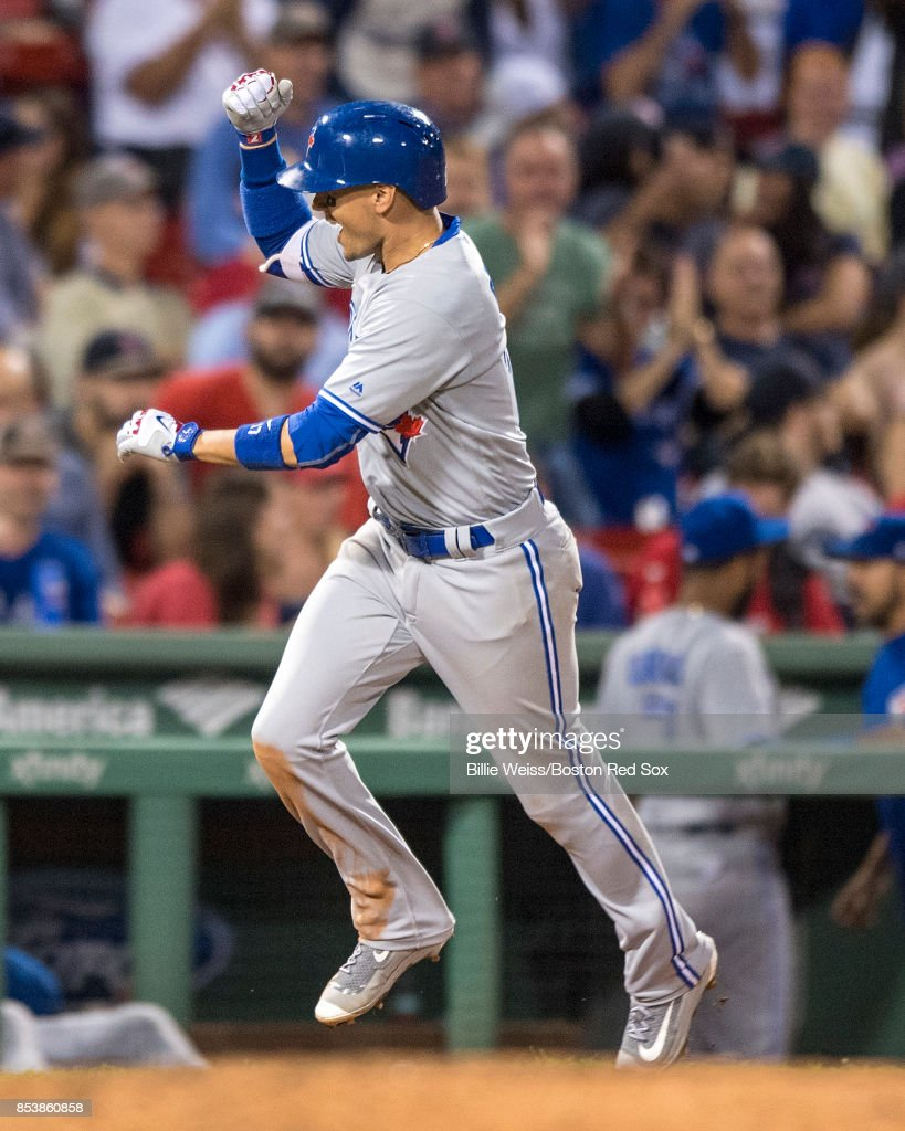 Ryan Goins #22 of the Toronto Blue Jays reacts after hitting a solo home run during the ninth inning of a game against the Boston Red Sox on September 25, 2017 at Fenway Park in Boston, Massachusetts.