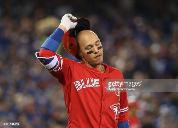 Ryan Goins of the Toronto Blue Jays reacts after lining out to end the fifth inning during MLB game action against the Baltimore Orioles at Rogers...