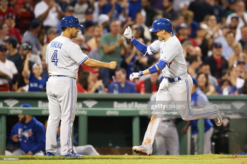 Ryan Goins #17 of the Toronto Blue Jays rounds the bases after hitting a solo home run in the ninth inning of a game against the Boston Red Sox at Fenway Park on September 25, 2017 in Boston, Massachusetts.