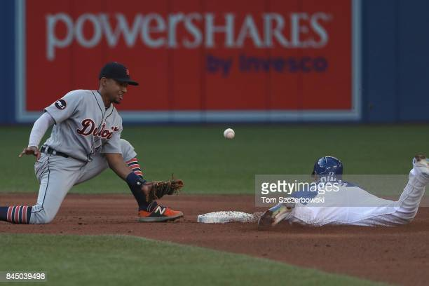Ryan Goins of the Toronto Blue Jays steals second base in the fifth inning during MLB game action as the ball gets away from Dixon Machado of the...