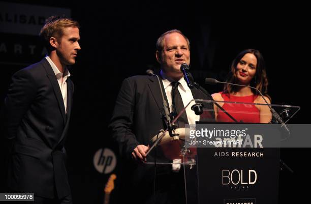 Ryan Gosling Harvey Weinstein and Emily Blunt speak during amfAR's Cinema Against AIDS 2010 benefit gala dinner at the Hotel du Cap on May 20 2010 in...