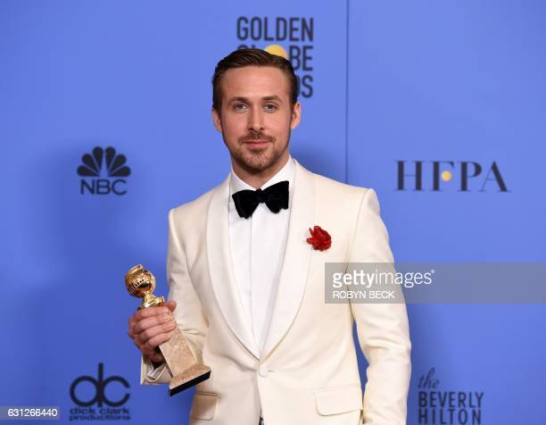 TOPSHOT Ryan Gosling poses with his award for best actor in a musical or comedy for his role in 'La La Land' in the press room during the 74th Annual...