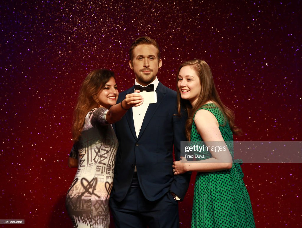 Ryan Gosling wax likeness with fans who are taking selfies as Madame Tussauds unveil their new Ryan Gosling wax figure at Madame Tussauds on July 23, 2014 in London, England.