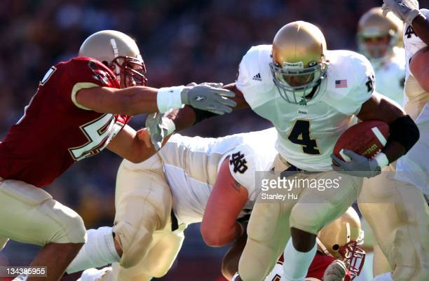 Ryan Grant of Notre Dame tries to get away from Josh Ott of Boston College during Boston College's 2725 victory over Notre Dame at Alumni Stadium in...