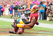 Ryan Grant of the Washington Redskins cannot catch the ball while being defended by Eric Rowe of the Philadelphia Eagles in the fourth quarter at...