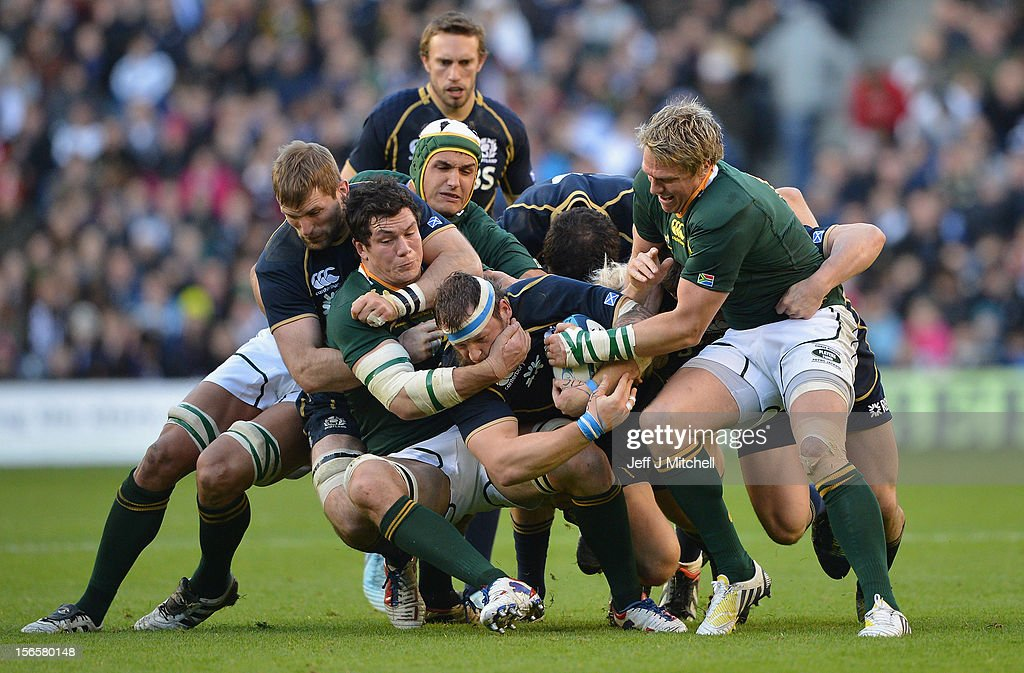 Ryan Grant Scotland is tackled by <a gi-track='captionPersonalityLinkClicked' href=/galleries/search?phrase=Francois+Louw&family=editorial&specificpeople=4389467 ng-click='$event.stopPropagation()'>Francois Louw</a> and <a gi-track='captionPersonalityLinkClicked' href=/galleries/search?phrase=Jean+de+Villiers&family=editorial&specificpeople=2285701 ng-click='$event.stopPropagation()'>Jean de Villiers</a> of South Africa during the international match between Scotland and South Africa at Murrayfield Stadium on November 17, 2012 in Edinburgh, Scotland.