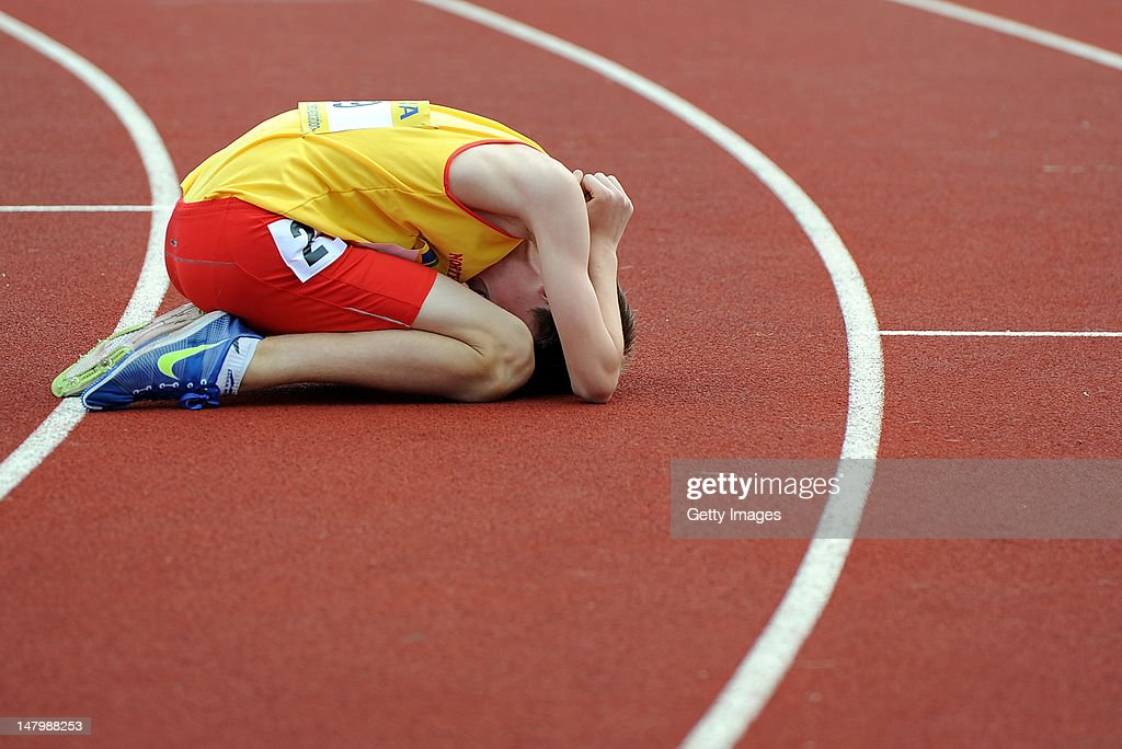 Ryan Green of Northumberland reacts after getting injured during the Junior Boys 800 Metres during Day 2 of the Aviva English Schools Track & Field Championships at the Gateshead International Stadium on July 7 in Gateshead, England. Search Aviva Athletics on Facebook to Back the Team.