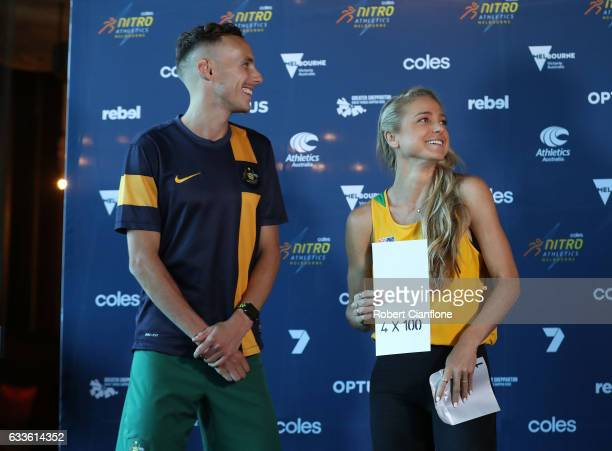 Ryan Gregson and Genevieve LaCaze of Team Australia open their envelope during a media opportunity for the Nitro Athletics series at Crown Palladium...