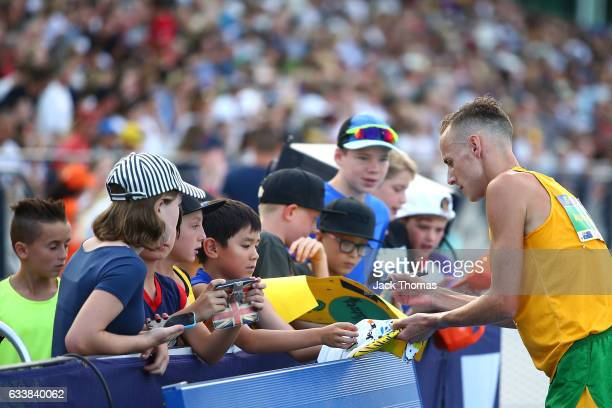 Ryan Gregson of Australia signs autographs following his Mixed Distance Medley during Nitro Athletics at Lakeside Stadium on February 4 2017 in...