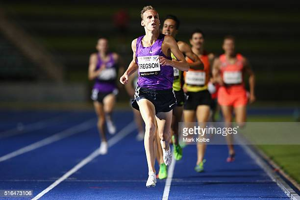 Ryan Gregson of the Victorian Institute of Sport crosses the line to win the men's 1500 metre open race during the 2016 Sydney Track Classic at...