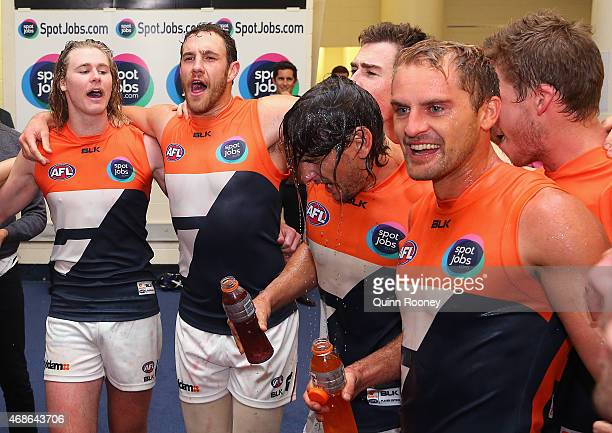 Ryan Griffen and Joel Patfull of the Giants sing the song in the rooms after winning the round one AFL match between the St Kilda Saints and the...