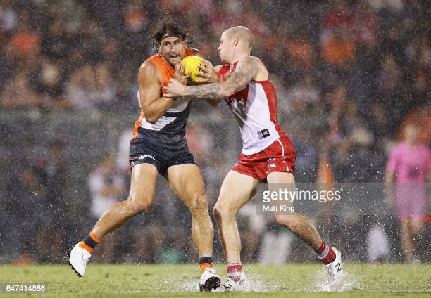Ryan Griffen of the Giants is challenged by Zak Jones of the Swans during the 2017 JLT Community Series AFL match between the Greater Western Sydney...