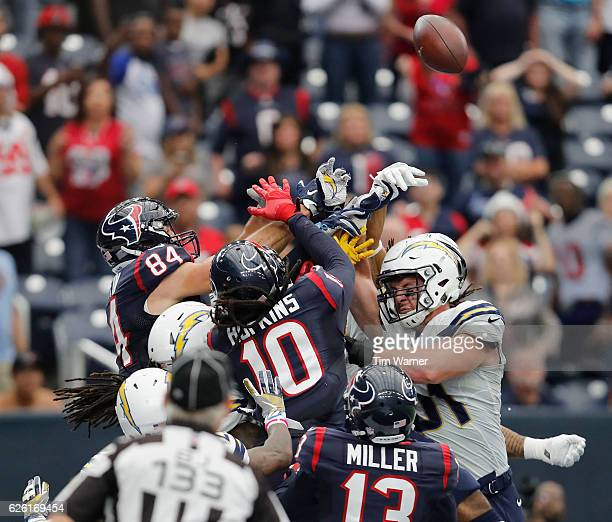 Ryan Griffin of the Houston Texans and DeAndre Hopkins of the Houston Texans battle with Kyle Emanuel of the San Diego Chargers for a pass in the...