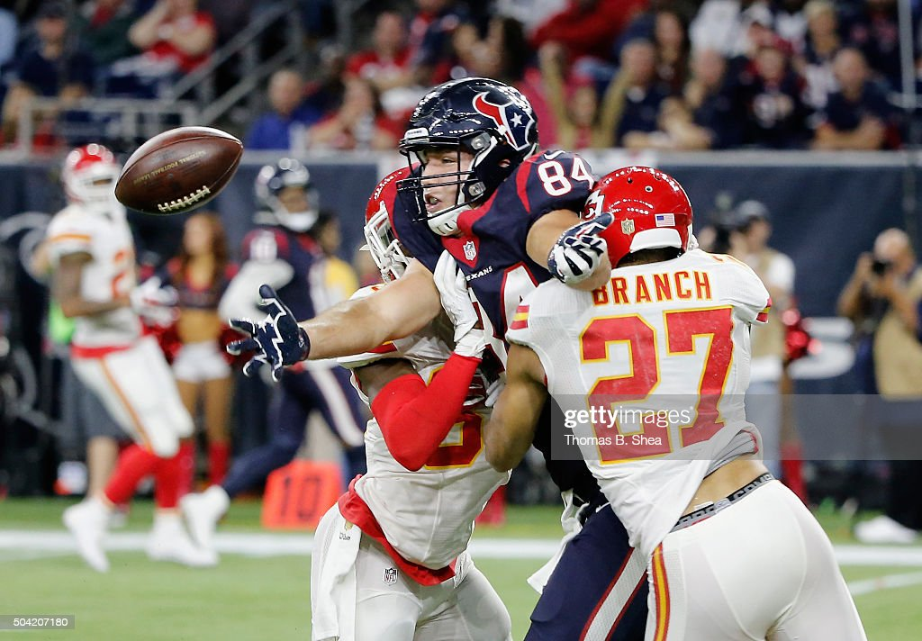 Ryan Griffin #84 of the Houston Texans drops the ball as he is pressured by <a gi-track='captionPersonalityLinkClicked' href=/galleries/search?phrase=Tyvon+Branch&family=editorial&specificpeople=4517063 ng-click='$event.stopPropagation()'>Tyvon Branch</a> #27 and <a gi-track='captionPersonalityLinkClicked' href=/galleries/search?phrase=Husain+Abdullah&family=editorial&specificpeople=2190074 ng-click='$event.stopPropagation()'>Husain Abdullah</a> #39 of the Kansas City Chiefs during the fourth quarter of the AFC Wild Card Playoff game at NRG Stadium on January 9, 2016 in Houston, Texas. The Chiefs won 30-0 over the Texans.