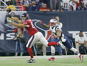 Ryan Griffin of the Houston Texans drops the ball while being covered by Patrick Chung of the New England Patriots in the fourth quarter on December...