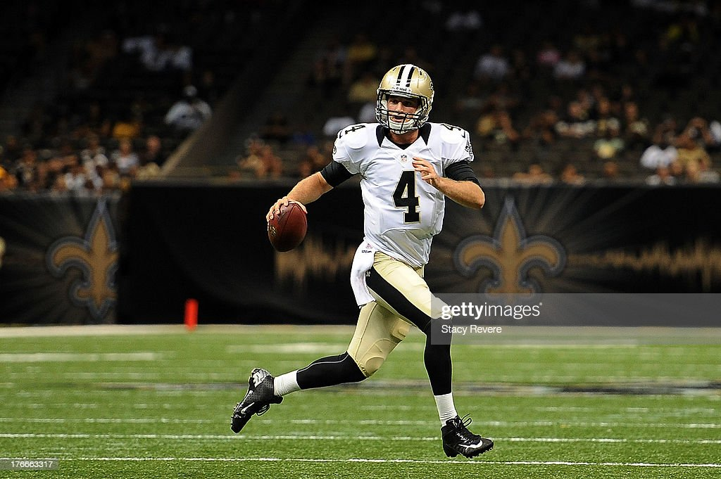 Ryan Griffin #4 of the New Orleans Saints looks for an open receiver during a preseason game against the Oakland Raiders at the Mercedes-Benz Superdome on August 16, 2013 in New Orleans, Louisiana.
