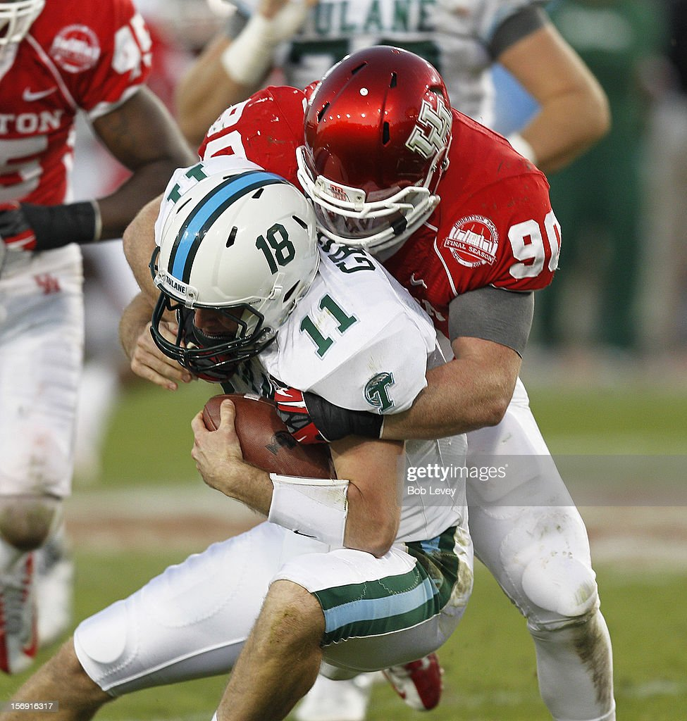 Ryan Griffin #11 of the Tulane Green Wave is sacked by Zeke Riser #90 of the Houston Cougars at Robertson Stadium on November 24, 2012 in Houston, Texas. Houston defeats Tulane 40-17.