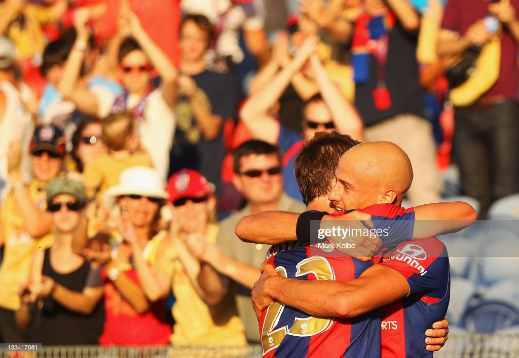 Ryan Griffiths and Ruben Zadkovich of the Jets celebrate after Griffiths scored a goal during the round seven ALeague match between the Newcastle...