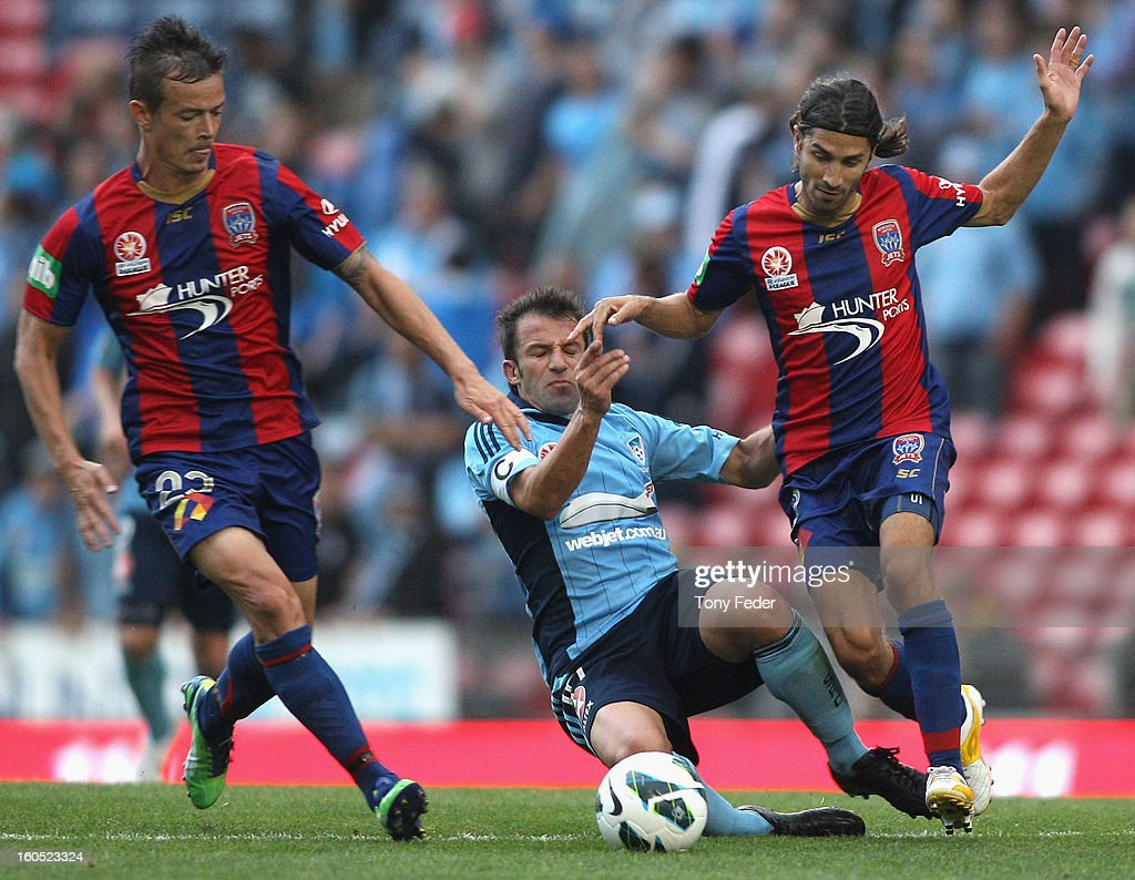 Ryan Griffiths and Zenon Caravella of the Jets sandwich Alassandro Del Piero of Sydney during the round 19 A-League match between the Newcastle Jets and Sydney FC at Hunter Stadium on February 2, 2013 in Newcastle, Australia.