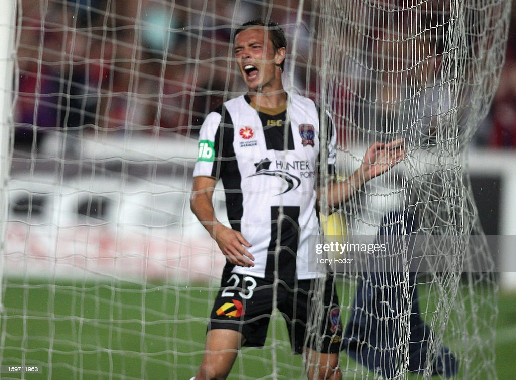 Ryan Griffiths of Newcastle reacts after missing a goal during the round 17 ALeague match between the Central Coast Mariners and the Newcastle Jets...
