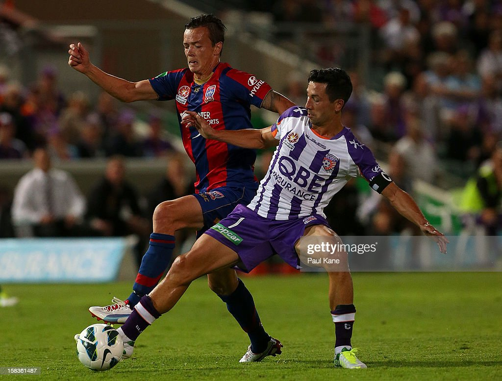 Ryan Griffiths of the Jets and Jacob Burns of the Glory contest for the ball during the round 11 ALeague match between the Perth Glory and the...