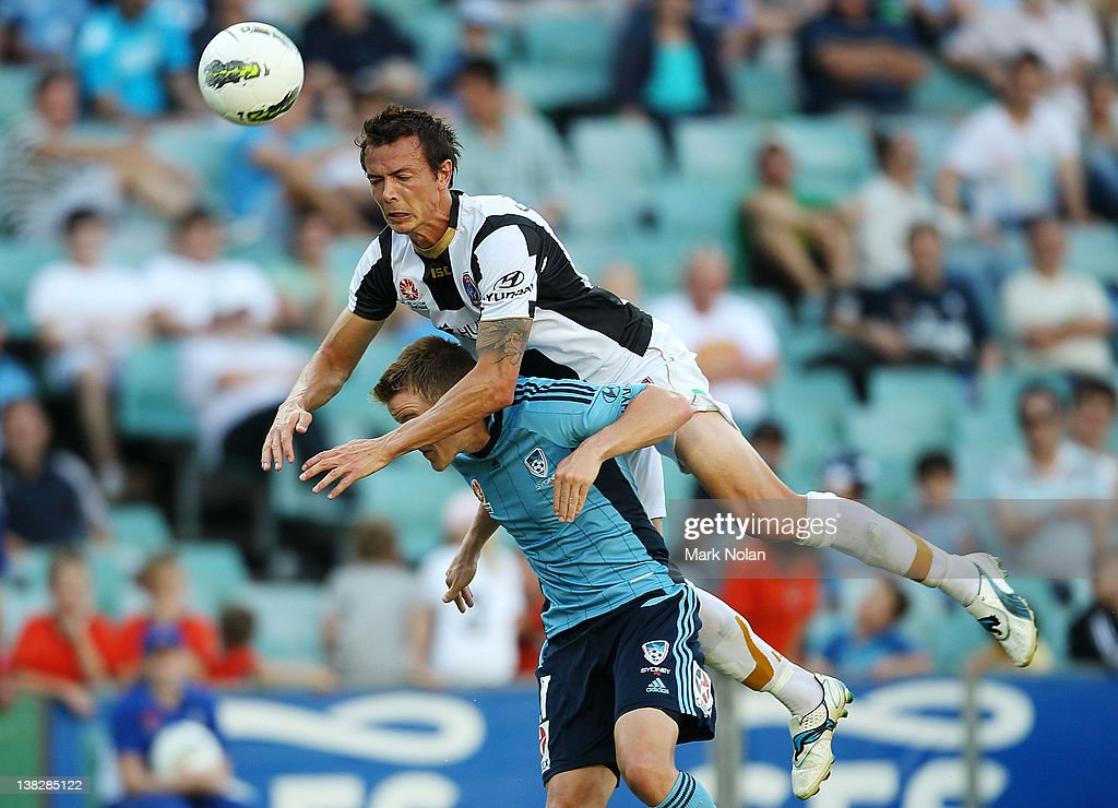 Ryan Griffiths of the Jets and Scott Jamieson of Sydney contest possession during the round 18 NBL match between Sydney FC and the Newcastle Jets at...