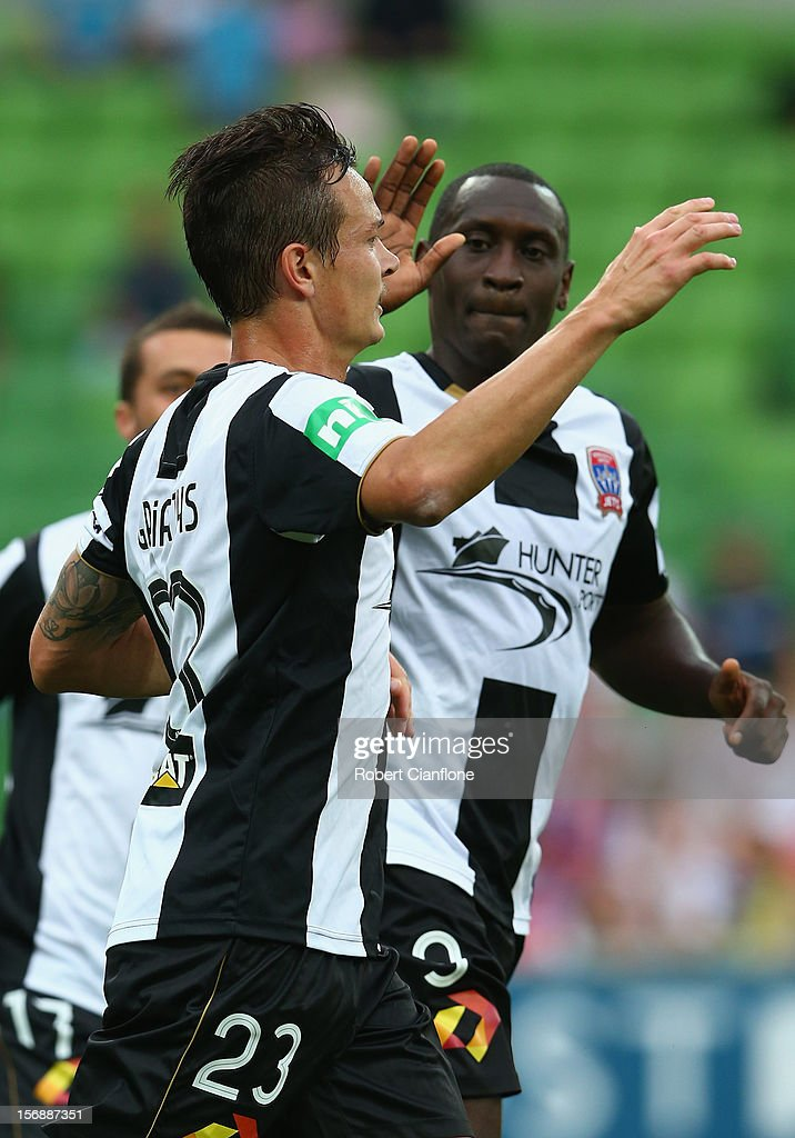 Ryan Griffiths of the Jets celebrates his goal with team mate Emile Heskey during the round eight ALeague match between the Melbourne Heart and the...