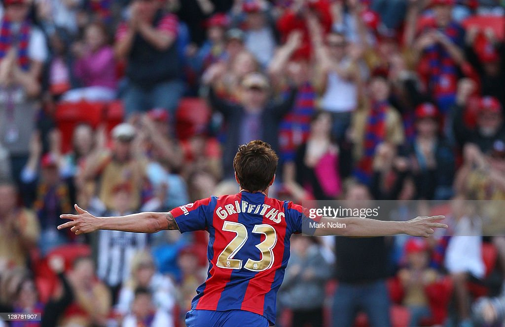 Ryan Griffiths of the Jets celebrates scoring his second goal during the round one ALeague match between the Newcastle Jets and the Melbourne Heart...