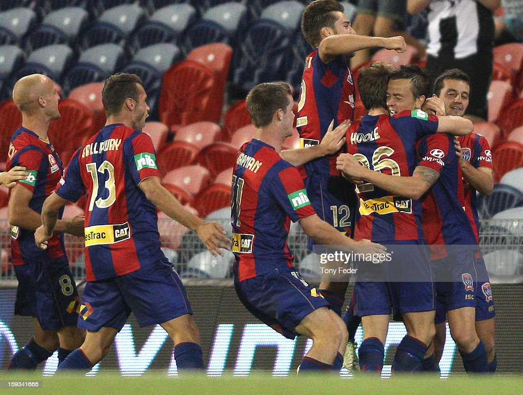 Ryan Griffiths of the Jets celebrates with his teammates after scoring the winning goal during the round 16 ALeague match between the Newcastle Jets...