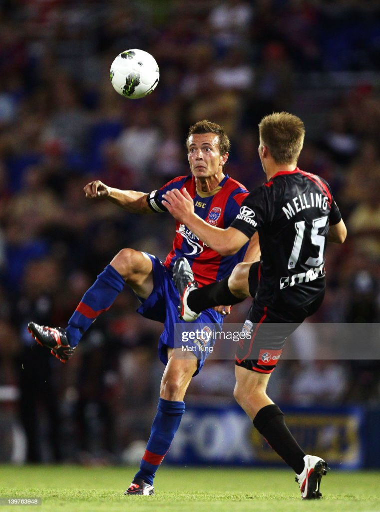 Ryan Griffiths of the Jets controls the ball in front of Jacob Melling of United during the round 21 ALeague match between the Newcastle Jets and...