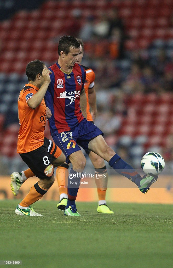 Ryan Griffiths of the Jets controls the ball in front of Massimo Murdocca of the Roar during the round 16 A-League match between the Newcastle Jets and the Brisbane Roar at Hunter Stadium on January 12, 2013 in Newcastle, Australia.