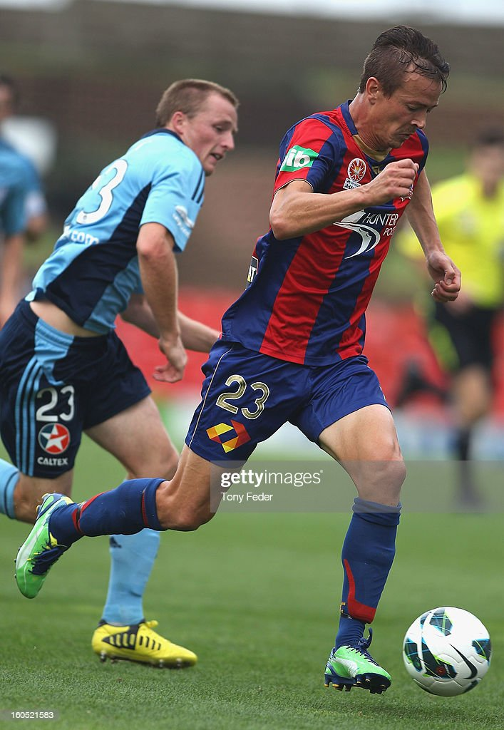 Ryan Griffiths of the Jets controls the ball in front of Rhyan Grant of Sydney during the round 19 A-League match between the Newcastle Jets and Sydney FC at Hunter Stadium on February 2, 2013 in Newcastle, Australia.