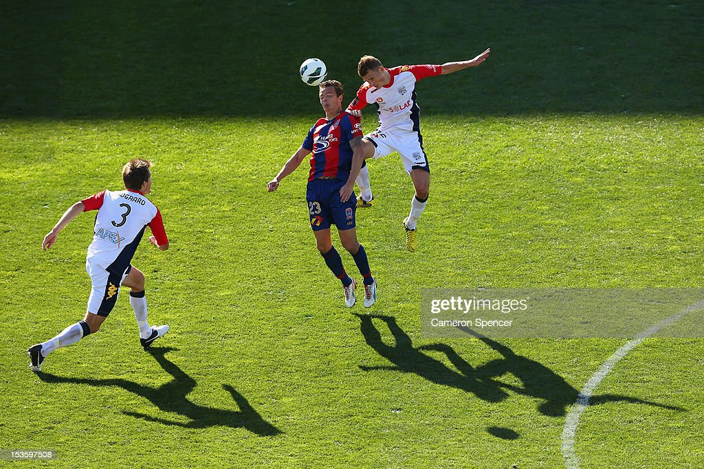 Ryan Griffiths of the Jets heads the ball with Daniel Bowles of Adelaide during the round one ALeague match between the Newcastle Jets and Adelaide...