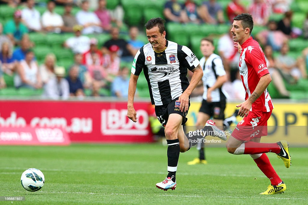 Ryan Griffiths of the Jets is chased by Jason Hoffman of the Heart during the round eight ALeague match between the Melbourne Heart and the Newcastle...