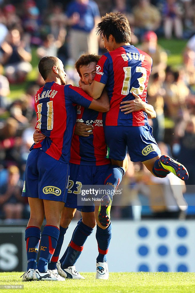 Ryan Griffiths of the Jets is congratulated after scoring his first goal during the round one ALeague match between the Newcastle Jets and the...