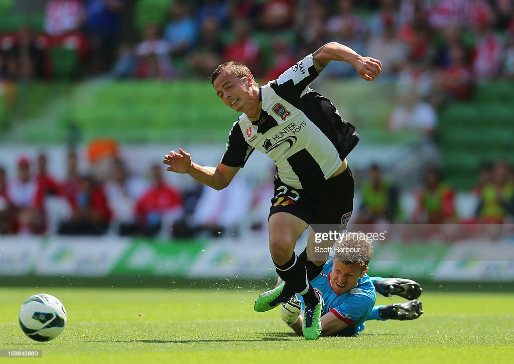 Ryan Griffiths of the Jets is fouled by goalkeeper Andrew Redmayne of the Heart which led to a goal from the penalty spot during the round 14 ALeague...